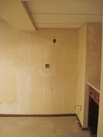 During: The wallpaper has been scraped off.