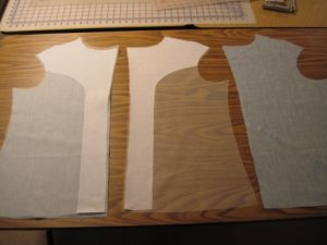 The silk organza underlining with the fusible woven interfacing for additional support at shoulder and down center front. It will be hand-basted to the front (right). The other front (left) has been underlined.