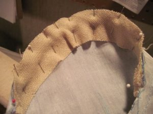 A sleeve head fills out the sleeve cap.