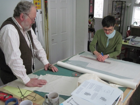 Tracing the marks from the muslin onto paper to make pattern pieces, under Steve Pauling's watchful eye.