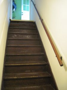 The staircase awaits refinishing, and the handrail, replacing.