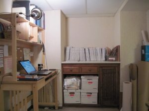 I must edit my boxes of patterns and reinstall the cabinet doors. Shelving added to the alcove will house my sewing library.