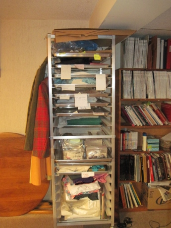 The rack of unfinished projects that furnished abundant material for Getting Things Sewn.