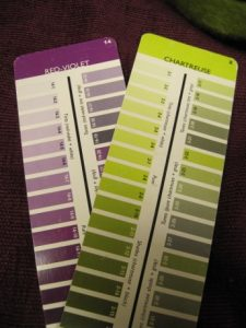 The scarf matches a shade on the Chartreuse card. The complementary colors of Red-Violet are also wonderful. But the great color can't overcome the other problems.
