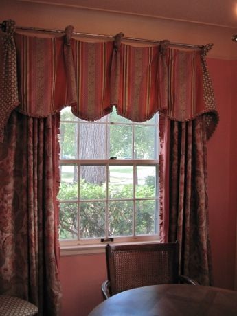 Small box pleating finishes the edge of the valance, while the leading edge of the drapery has a large version.