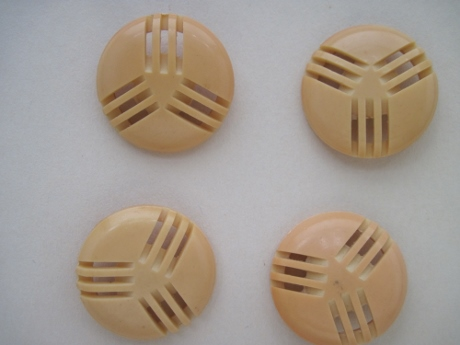 "These celluloid buttons, most likely from the 1930s, were purchased from a button collector's ""poke box."""