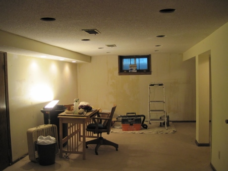 Holes for the recessed light fixtures. The shop light was taken down and upturned to light the ceiling work.
