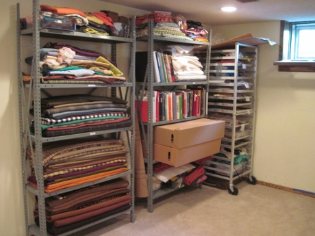 This was my sewing space last week. One set of shelves and most of its contents are in the cedar closet now.