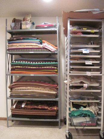 Today. Fabric stash on one set of shelves. Projects on the baker's rack. The serger is there, too--but that's another story!