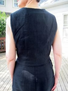 The waistcoat just covers the waist. I'll want to pair this with a skirt or pants with waist coverage to avoid a distracting gap.