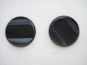 The one-inch buttons date probably to the 1930s.