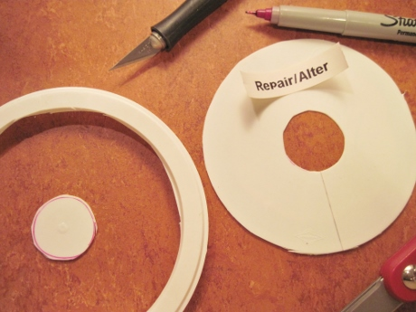 Cut from the hole to the outside edge so the disc can be fitted around the rod.