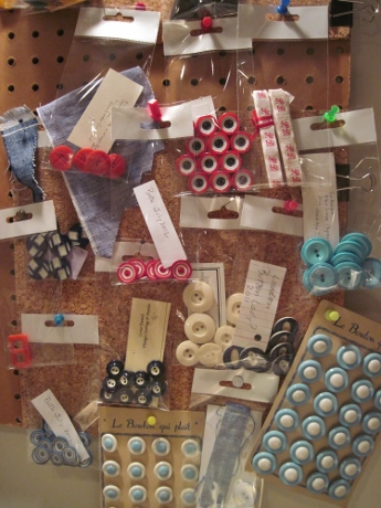 Swatches, buttons, buckles, initial tape for a quick idea board.