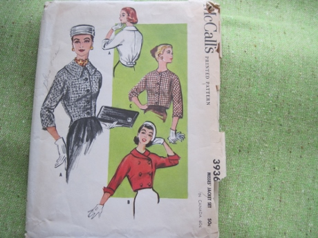 From 1956, ladylike jackets. Check out that bow on the back!