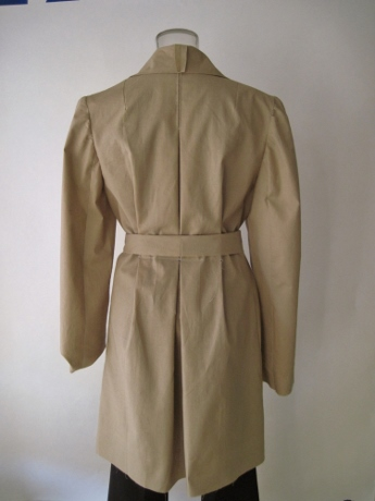 The prominent shoulders bring the eye up, and the center pleat creates verticality.