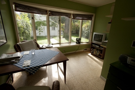 The sunroom before a quick conversion to a photo space.