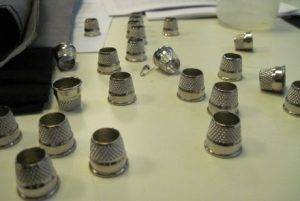 Tailors' thimbles. Tricky little busters.
