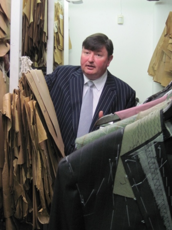 Peter Smith showing us pattern pieces in storage and garments awaiting alteration, completion or repairs.