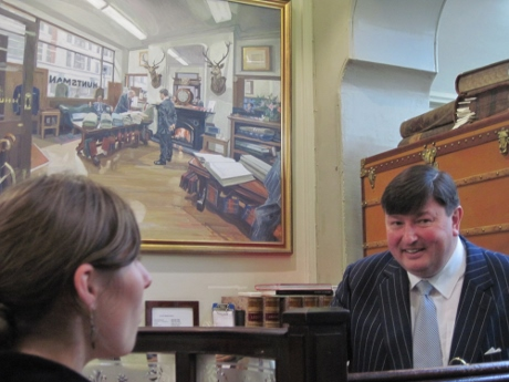 A classmate and Peter Smith, with a painting of Huntsman in the background.