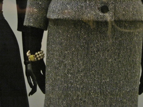 I love the black gloves paired with the bracelet sleeves--and the Schiaparelli bracelet.