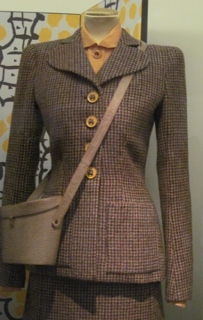 A woman's utility suit designed in accordance with fabric and button restrictions during World War II