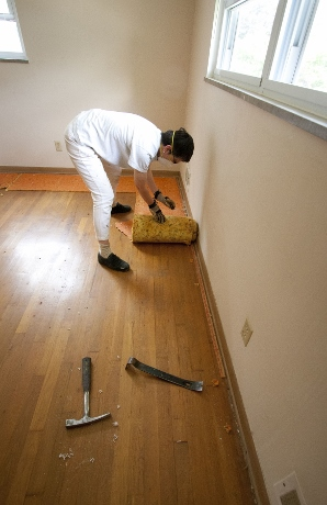 Removing the crumbling padding revealed oak flooring in decent shape.