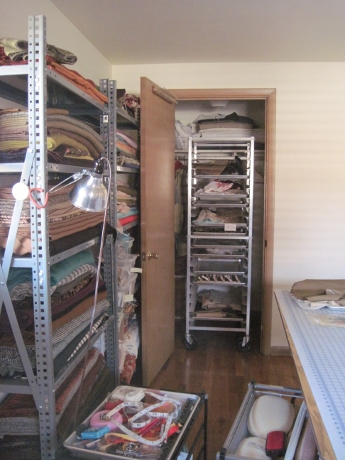 The rolling baker's rack, which holds unfinished projects, fits perfectly into the closet.