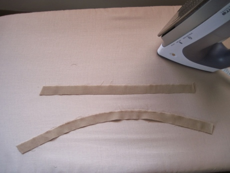 Muslin strips: one is straight (not stretched or pressed); the other is slightly curved after stretching and pressing (feeble first attempt).