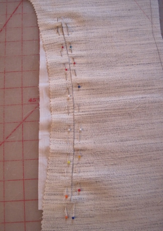 The cut edges are butted together. The muslin strip is pinned underneath.