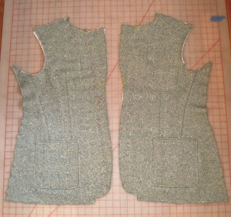 The body canvases have been basted to the fronts. Unfortunately, the white thread is hard to see on this tweed.