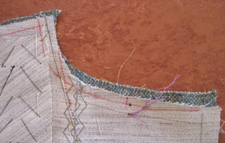The red line is the new line for trimming the canvas out of the 1/2 inch seam allowance. The red line at the shoulder turned out to be a mistake. Kenneth doesn't show the canvas being trimmed from the shoulder.