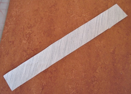 A 2-inch strip of tailors' canvas, cut on the bias so it will curve smoothly rather than ripple.