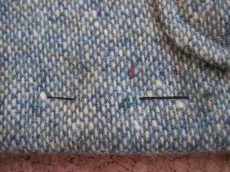 Here's one stitch that is visible. If I had used a matching thread it wouldn't be a problem in this textured tweed.