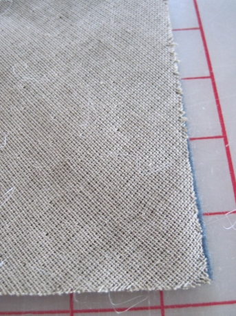 This canvas was bias-cut and then attached to the felt with almost invisible stitches.