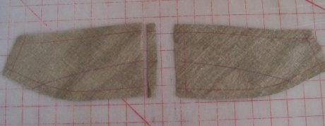 The seam allowance of one undercollar canvas is trimmed, and then the seam is lapped and stitched with a serpentine stitch.