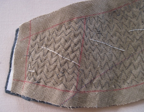 One end of an undercollar, pad stitched to create a curve.