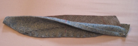 The upper collar is pulled back to reveal the canvas, which will be trimmed in the next step.