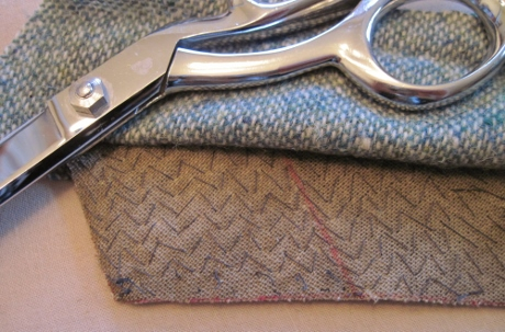 I pad stitched too close to the seam line and had to remove some of the stitches in order to trim the canvas back by 1/8 inch.