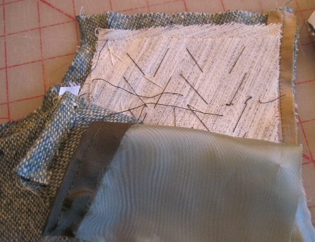 I mistakenly trimmed the canvas out of the shoulder seam allowance.  Kenneth keeps the canvas in the seam.