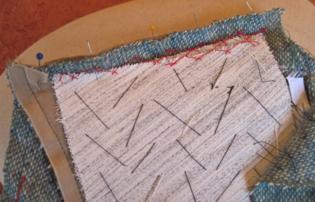 I catch stitched the canvas to the seam allowance since it wasn't going to be caught in the seam.
