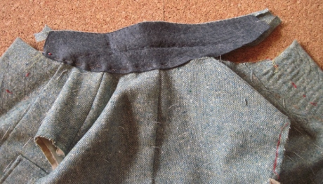 One side of the collar is pinned to the neckline.