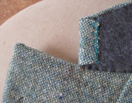 The upper collar edge is catch stitched to the undercollar. You can use matching or contrast thread.