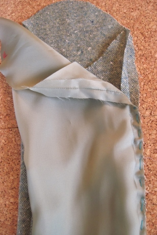 The running stitch starts about 6 inches down from the top of the seam and ends about 4 inches from the bottom.