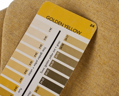 My trusty 3 in 1 Color Tool suggests that this yellow has been lightened with white and shaded with gray.