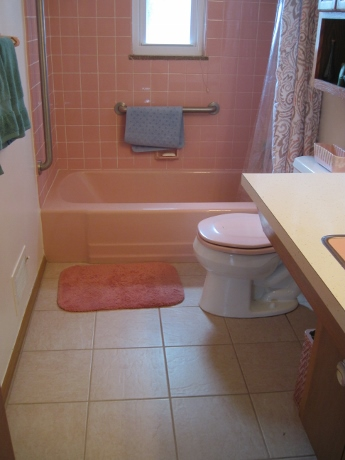 The upstairs bathroom, staged for sale.